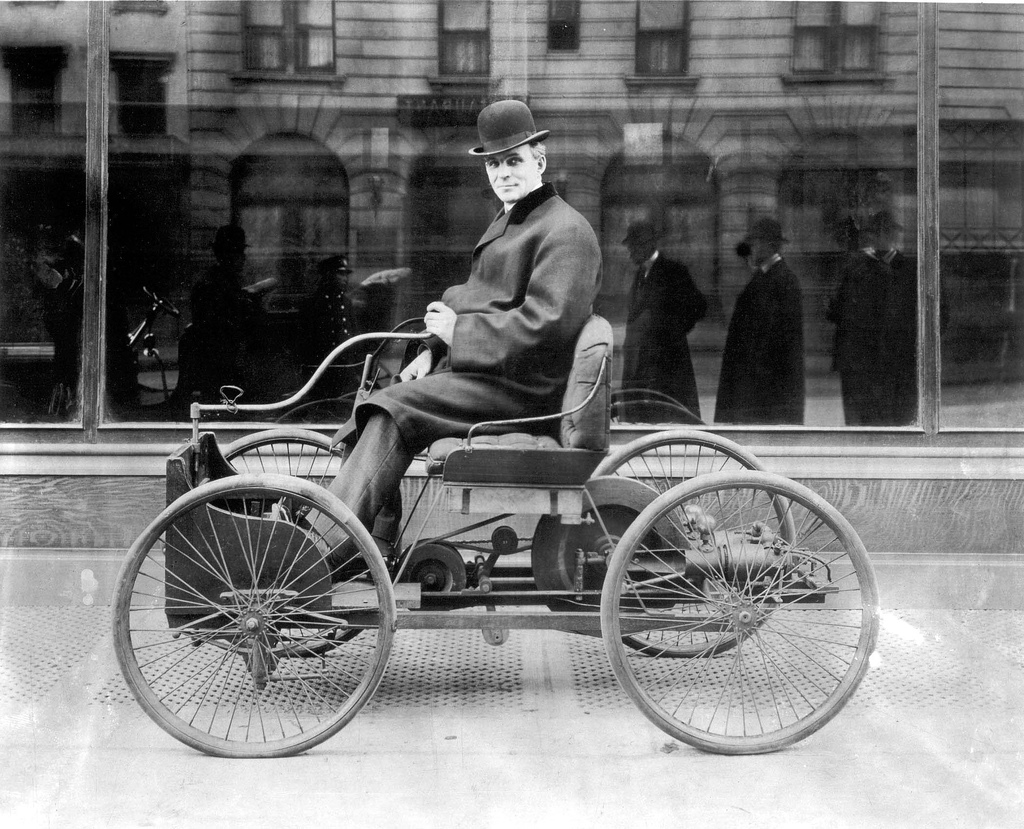 Henry Ford sits in his first automobile, the Ford Quadricycle, in 1896 - Newsweek